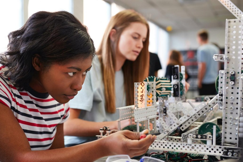 Two female students building an engineering project